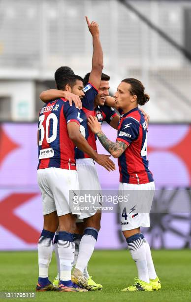 Koffi Djidji of F.C. Crotone celebrates with teammates after scoring their team's first goal during the Serie A match between Spezia Calcio and FC...