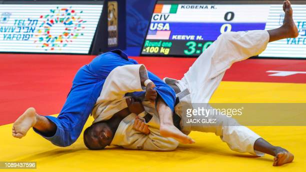Koffi Kreme Kobena of the Ivory Coast competes against Nate Keeve of the US during their men's under 100 kg weight category match at the Tel Aviv...