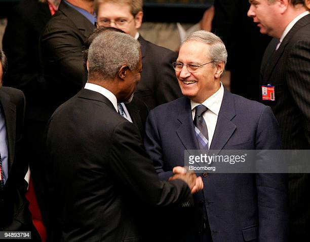 Kofi Annan left Secretary General of United Nations left shakes hands with Syrian Foreign Minister Faruq AlShara right before a special ministerial...