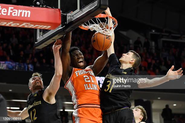 Kofi Cockburn of the Illinois Fighting Illini dunks in the first half against Robbie Beran of the Northwestern Wildcats at Welsh-Ryan Arena on...