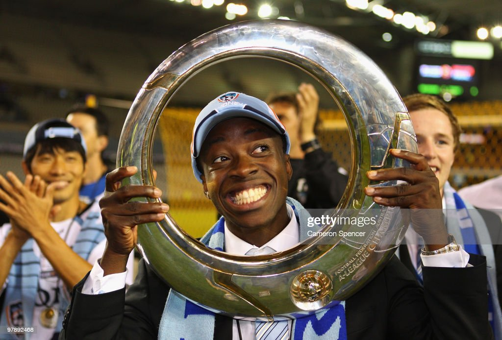 Kofi Danning of Sydney FC poses with the trophy after winning the A-League Grand Final match between the Melbourne Victory and Sydney FC at Etihad Stadium on March 20, 2010 in Melbourne, Australia.