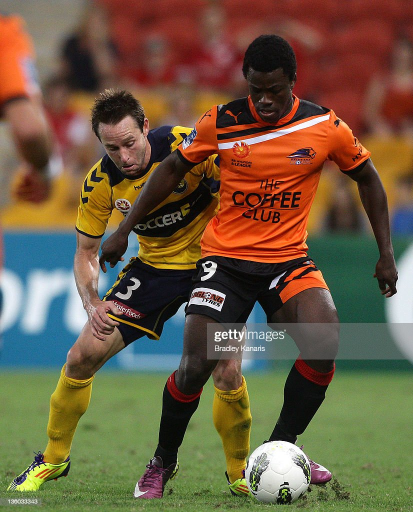 Kofi Danning of the Roar and Joshua Rose of the Mariners compete for the ball during the round 11 A-League match between the Brisbane Roar and the Central Coast Mariners at Suncorp Stadium on December 17, 2011 in Brisbane, Australia.