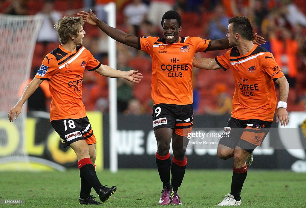 Kofi Danning of the Roar celebrates after scoring a goal during the round 11 A-League match between the Brisbane Roar and the Central Coast Mariners at Suncorp Stadium on December 17, 2011 in Brisbane, Australia.