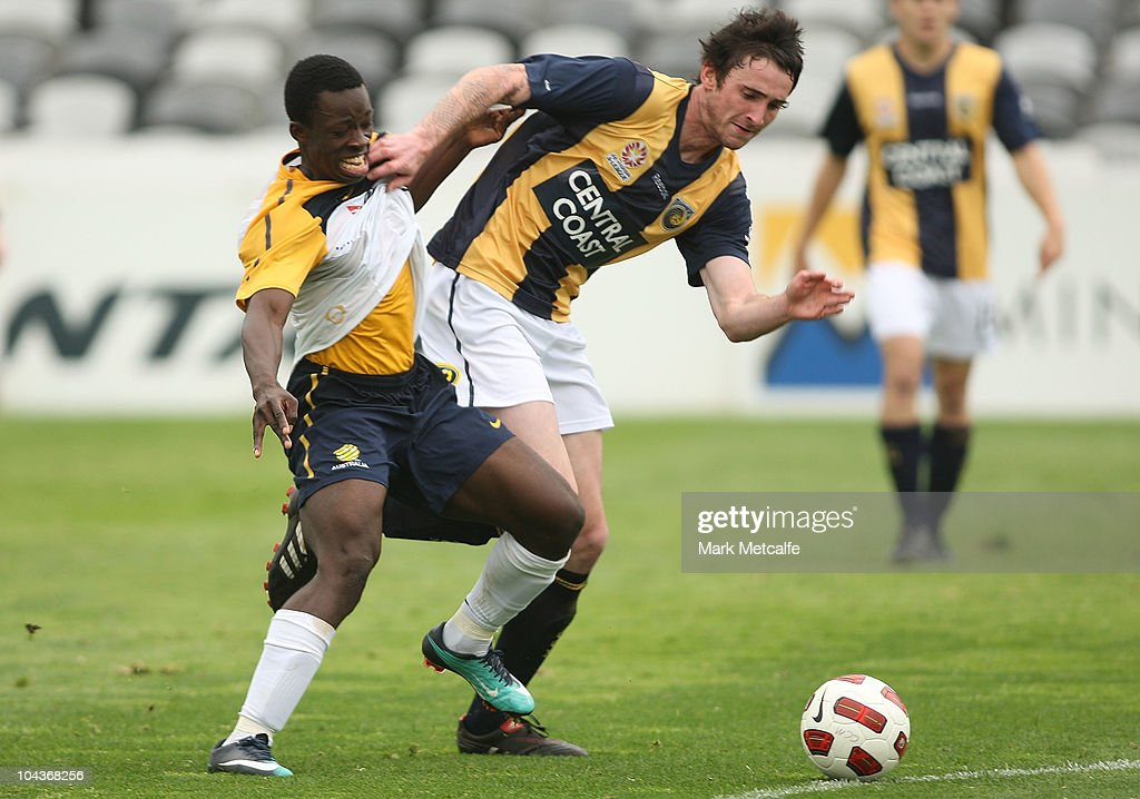 Kofi Danning of the Young Socceroos is tackled during the friendly match between the Young Socceroos and the Central Coast Mariners at Bluetongue Stadium on September 23, 2010 in Gosford, Australia.