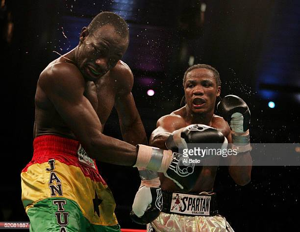 Kofi Jantuah gets spun around by a right from Kassim Ouma during their bout for the IBF Junior Middleweight Championship at Boardwalk Hall on January...