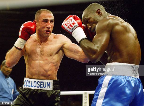 Kofi Jantuah of Ghana fights Artur Abraham of Germany during their IBF World Championship Middleweight fight at the town hall on May 13, 2006 in...