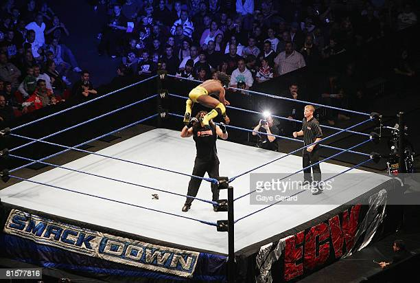 Kofi Kingston leaps from the turnbuckle against Chuck Palumbo during WWE Smackdown at Acer Arena on June 15 2008 in Sydney Australia