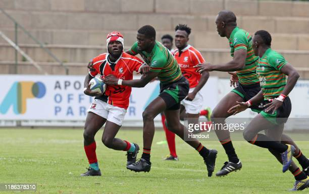 Kofi Montchon of Ghana challenged by Masabo Mike of Zambia during the 2019 Rugby Africa Mens 7s match between Ghana and Zambia at the Bosman Stadium...