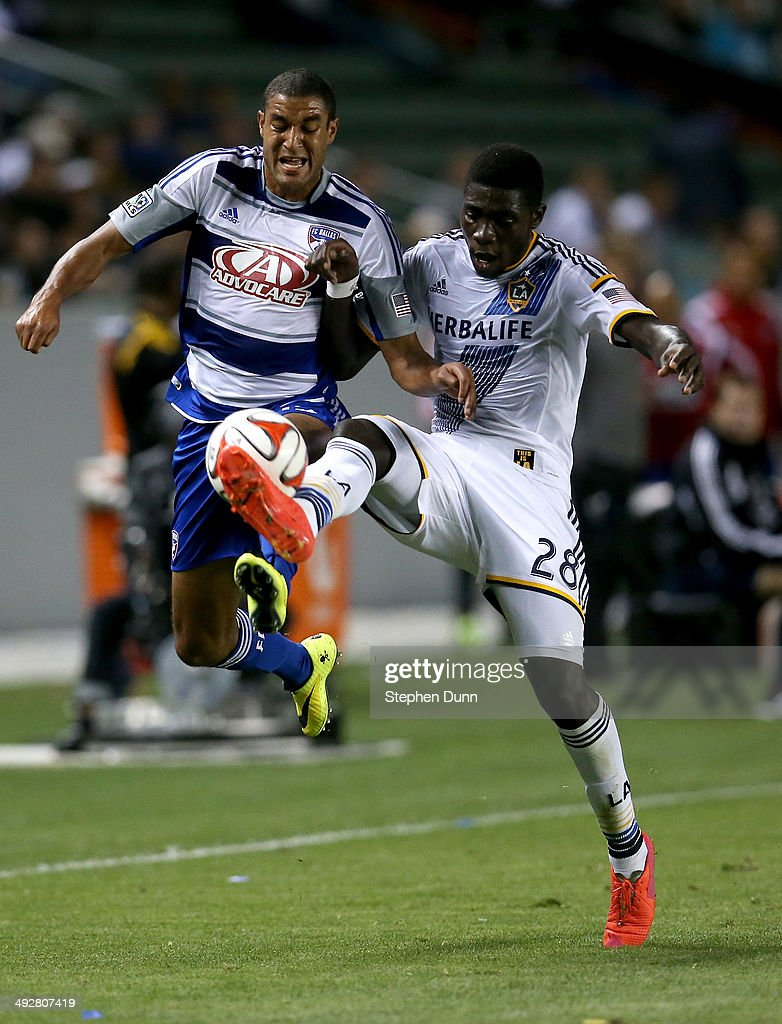 Kofi Opare #28 of the Los Angeles Galaxy kicks the ball away from Tesho Akindele #13 of FC Dallas at StubHub Center on May 21, 2014 in Los Angeles, California.