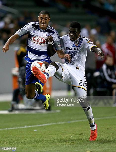 Kofi Opare of the Los Angeles Galaxy kicks the ball away from Tesho Akindele of FC Dallas at StubHub Center on May 21 2014 in Los Angeles California