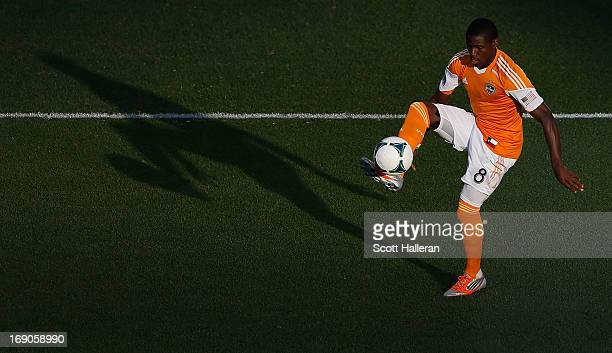 Kofi Sarkodie of Houston Dynamo plays a ball in the first half against Sporting Kansas City at BBVA Compass Stadium on May 12 2013 in Houston Texas
