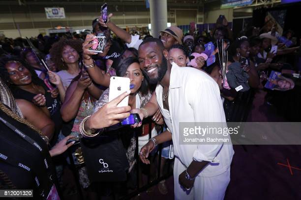Kofi Siriboe from the movie Girls Trip takes photos with fans during the Essence Music Festival at the Ernest N Morial Convention Center on July 1...