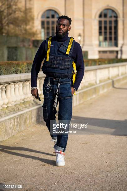 Kofi Siriboe wearing a blue turtleneck denim OffWhite vest blue jeans and Nike shoes is seen in the streets of Paris before the OffWhite show on...