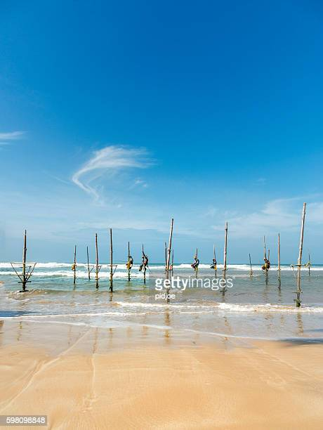 Koggala beach, village near Galle, stilt fishermen