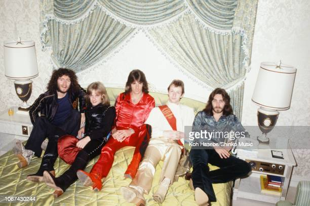 Koh Hasebe/Shinko Music/Getty Images: Judas Priest, group portrait on a bed during an interview and photo session for Music Life magazine, at a hotel...