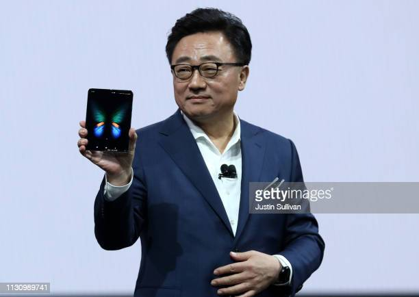 Koh President and CEO of IT Mobile Communications Division of Samsung Electronics holds the new Samsung Galaxy Fold smartphone during the Samsung...