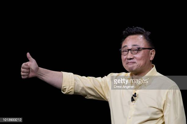 Koh president and CEO of Samsung Electronics gives the thumbs up during a product launch event for the Samsung Galaxy Note 9 smartphone at the...