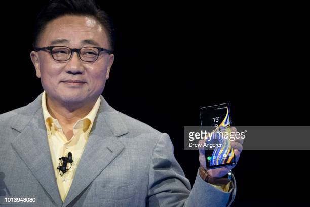 Koh president and CEO of Samsung Electronics introduces the new Samsung Galaxy Note 9 smartphone at the Barclays Center August 9 2018 in the Brooklyn...