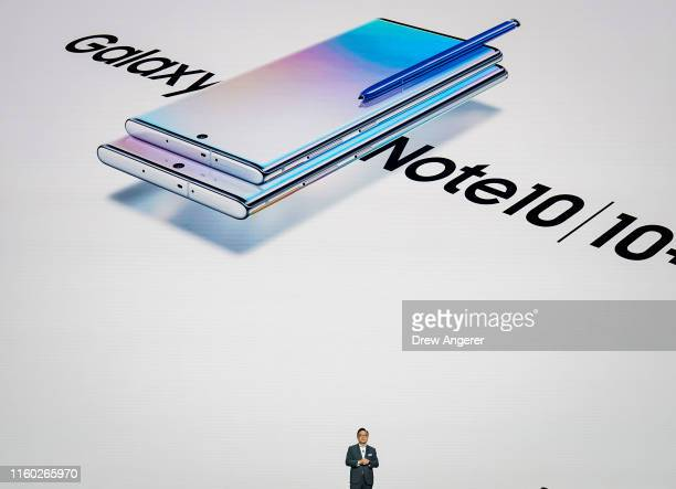Koh president and CEO of Samsung Electronics presents the Samsung Galaxy Note 10 smartphone during a launch event at Barclays Center on August 7 2019...
