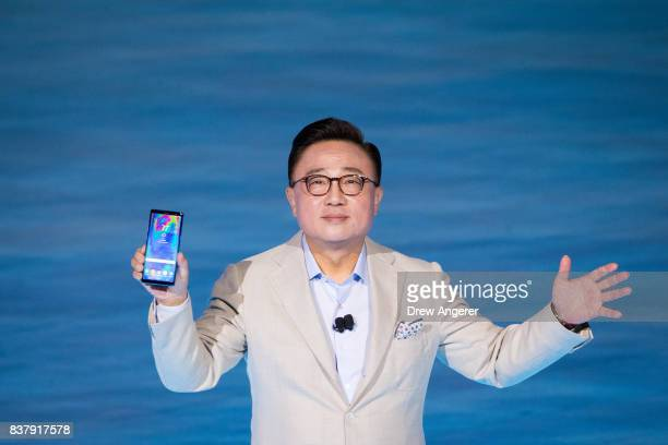 Koh president of mobile communications business at Samsung holds up the new Samsung Galaxy Note8 smartphone during a launch event for the new product...