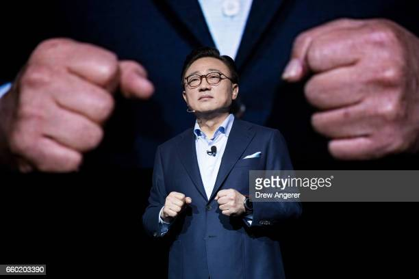 Koh president of mobile communications business at Samsung speaks as he prepares to introduce the new Samsung Galaxy S8 during a launch event March...