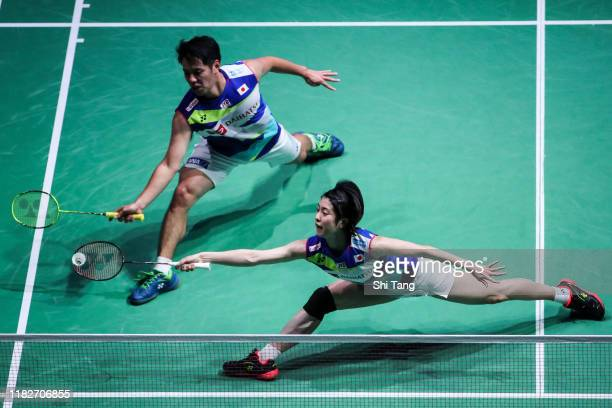Kohei Gondo and Ayane Kurihara of Japan compete in the Mixed Doubles first round match against Rinov Rivaldy and Pitha Haningtyas Mentari of...