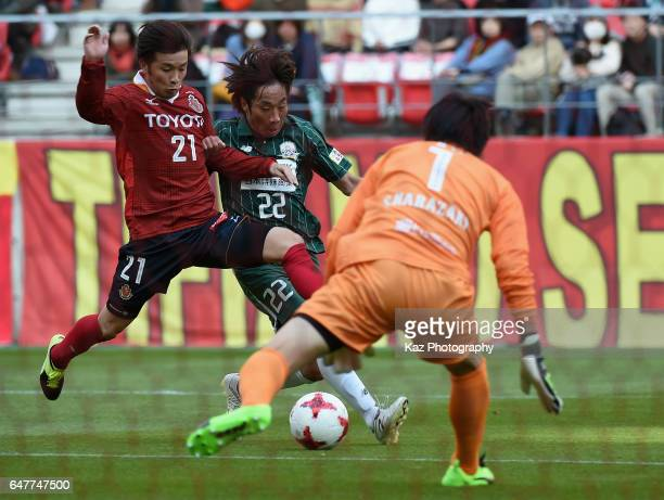Kohei Hattanda of Nagoya Grampus and Kohei Yamada of FC Gifu compete for the ball during the JLeague J2 match between Nagoya Grampus and FC Gifu at...