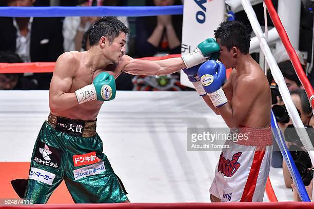 Kohei Kono of Japan punches Inthanon Sithchamuang of Thailand during the WBA World Super Flyweight title bout between Kohei Kono and Inthanon...