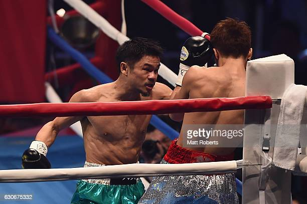 Kohei Kono punches by Naoya Inoue during the WBO World Super Flyweight Title bout between Naoya Inoue and Kohei Kono of Japan at the Ariake Colosseum...