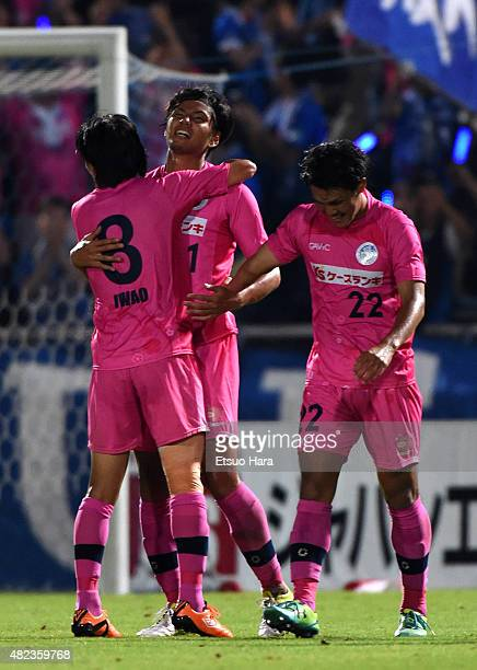 Kohei Mishima of Mito Hollyhock celebrates scoring his team's second goal with his team mates Ken Iwao and Kohei Uchida during the JLeague second...