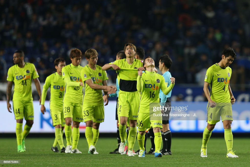 Kohei Shimizu (2nd R) and Sanfrecce Hiroshima players celebrate their 1-0 victory after the J.League J1 match between Gamba Osaka and Sanfrecce Hiroshima at Suita City Football Stadium on April 7, 2017 in Suita, Osaka, Japan.