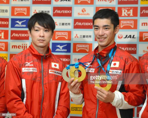 Kohei Uchimura and Kenzo Shirai attend a press conference on arrival at Narita International Airport on October 10 2017 in Narita Chiba Japan