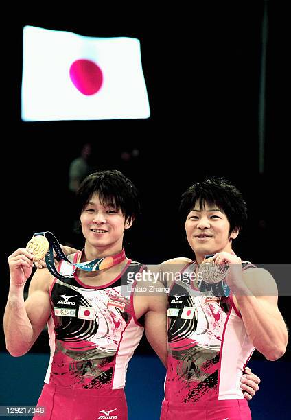 Kohei Uchimura and Koji Yamamuro of Japan celebrate winning the Gold and Bronze medals in the Men's All Around Final during day eight of the Artistic...