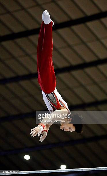 Kohei Uchimura competes in the horizontal bar of the Men's All Around during the NHK Trophy Artistic Gymnastics Championship at National Yoyogi...