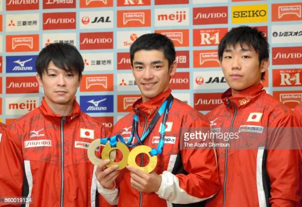 Kohei Uchimura Kenzo Shirai and Hidetaka Miyachi attend a press conference on arrival at Narita International Airport on October 10 2017 in Narita...