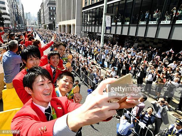Kohei Uchimura Koji Yamamuro Ryohei Kato Kenzo Shirai and Yusuke Tanaka take selfies on the double decker bus during the Rio Olympics 2016 Japanese...