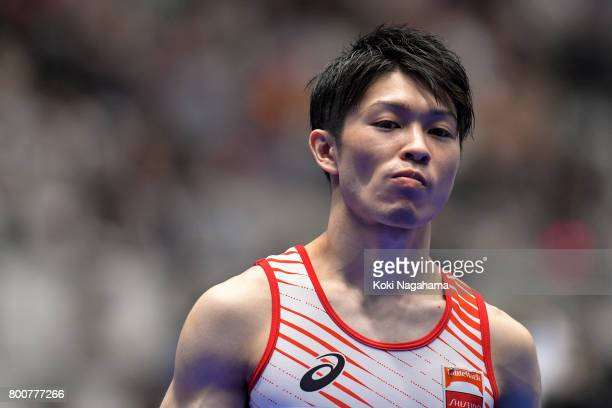 Kohei Uchimura looks on after competing in the Horizontal Bar during Japan National Gymnastics Apparatus Championships at the Takasaki Arena on June...