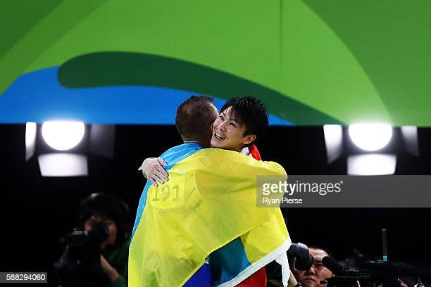 Kohei Uchimura of Japan and Oleg Verniaiev of Ukraine embrace after winning the gold and silver medal respectively in the Men's Individual AllAround...