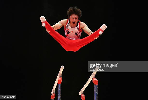 Kohei Uchimura of Japan competes in the Parallel Bars during Day Three of the 2015 World Artistic Gymnastics Championships at The SSE Hydro on...