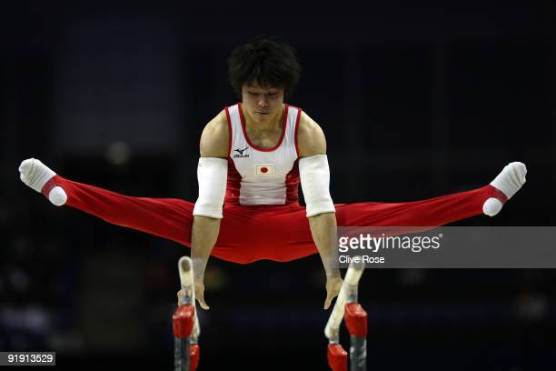 Kohei Uchimura of Japan competes in the parallel bars during the Men's All Round Final on the third day of the Artistic Gymnastics World...