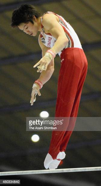 Kohei Uchimura of Japan competes on the High Bar during day two of the Artistic Gymnastics NHK Trophy at Yoyogi National Gymnasium on June 8 2014 in...
