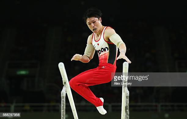 Kohei Uchimura of Japan competes on the parallel bars during the Men's Individual AllAround final on Day 5 of the Rio 2016 Olympic Games at the Rio...