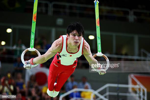 Kohei Uchimura of Japan competes on the rings in the Artistic Gymnastics Men's Team qualification on Day 1 of the Rio 2016 Olympic Games at Rio...