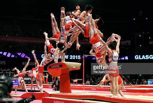 Kohei Uchimura of Japan completes the Li Xiaopeng hop routine in the Horse Vault of the Men's AllAround final during day eight of the 2015 World...