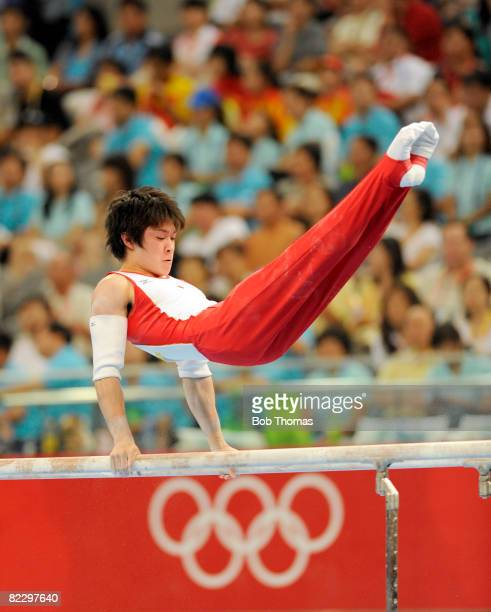 Kohei Uchimura of Japan on the parallel bars during the men's individual allaround final in the artistic gymnastics event at the National Indoor...