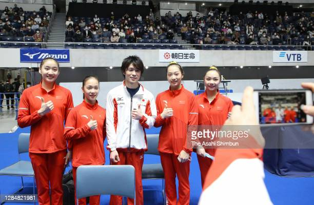 Kohei Uchimura of Japan poses for a selfie with Chinese female gymnasts after the artistic gymnastics Friendship and Solidarity Competition at the...