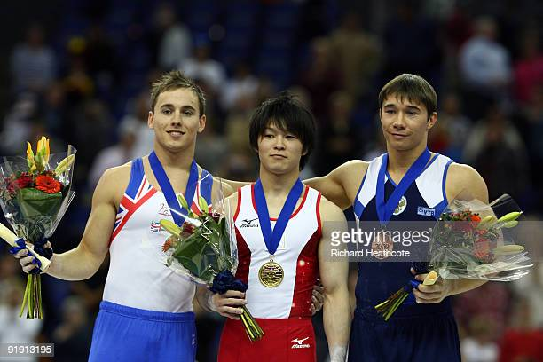 Kohei Uchimura of Japan poses with his gold medal next to Daniel Keatings of Great Britain and Yury Ryazanov of Russia after the Men's All Round...