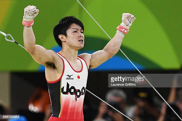 Kohei Uchimura of Japan reacts after competing on the horizontal bar during the Men's Individual AllAround final on Day 5 of the Rio 2016 Olympic...
