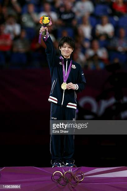 Kohei Uchimura of Japan smiles as he celebrates with his gold medal on the podium during the medal ceremony for the Artistic Gymnastics Men's...