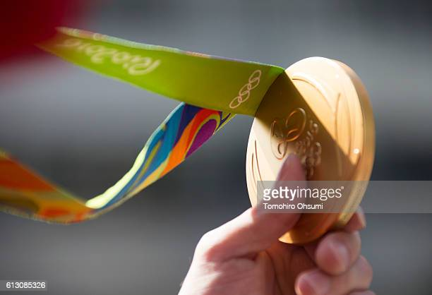Kohei Uchimura shows his medal on the top of a double decker bus during the Rio Olympics 2016 Japanese medalist parade in the ginza district on...
